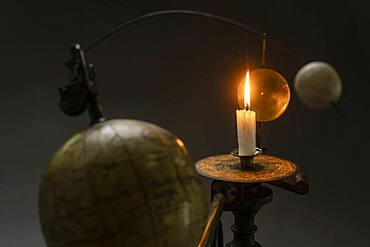 Antique globe and candle solar system model