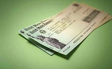 Studio shot of US government check for stimulus money