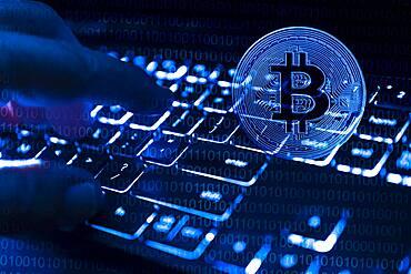 Fingers at computer keyboard and bitcoin, cgi