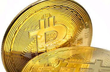 Close-up of golden bitcoins