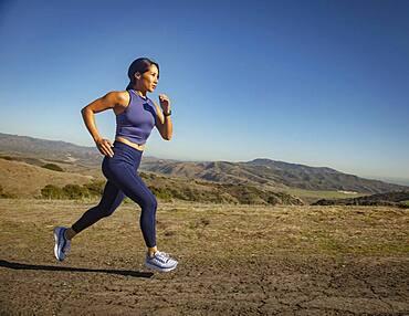 Woman jogging in landscape