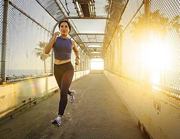Woman jogging at sunset