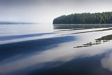New York, Calm Upper Saranac Lake surface at dawn