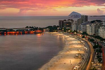 Brazil, Rio de Janeiro, Copacabana Avenida Atlantica and Copacabana Beach at sunset