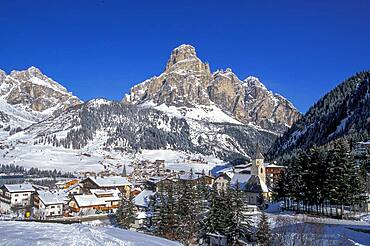Italy, Dolomites, Village covered with snow in mountain valley