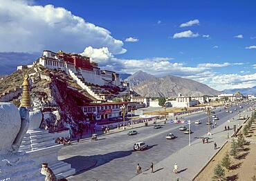 China, Tibet, Lhasa, Potala Palace and traffic on road