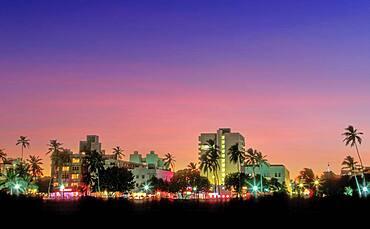 USA, Florida, Miami Beach, South Beach, Illuminated city skyline at sunset