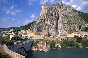 France, Provence, Sisteron, Rocher de la Baume mountain with village near Durance river