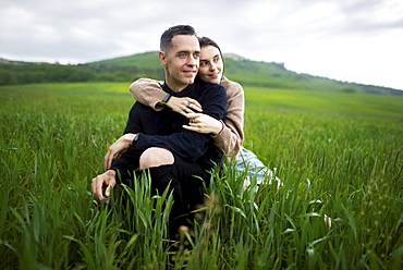 Young couple embracing in wheat field