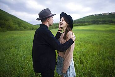 Smiling young couple in wheat field