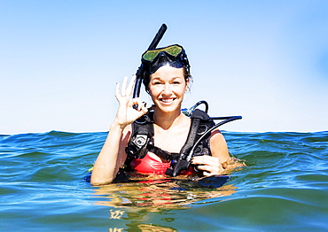 Portrait of young woman scuba-diving in sea, Jupiter, Florida