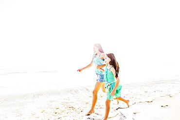 Mom and daughter (6-7) spending time together on beach, Jupiter, Florida
