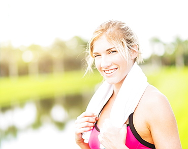 Portrait of smiling woman with towel around neck, Jupiter, Florida