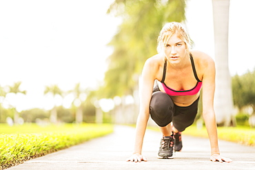 Woman exercising outdoors, Jupiter, Florida