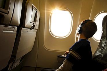 Boy (6-7) in plane