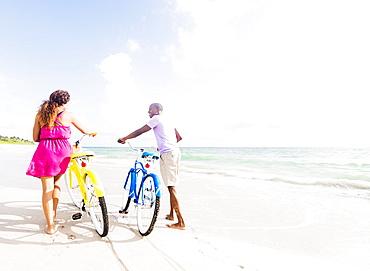 Young couple during bike trip, Jupiter, Florida