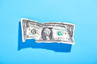 One dollar bill on blue background