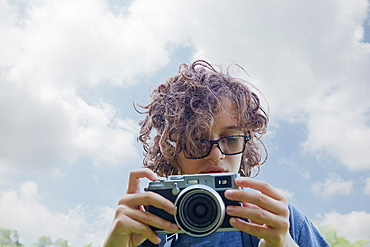 Boy taking picture with camera