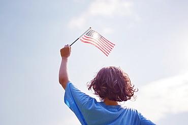 Boy waving American Flag
