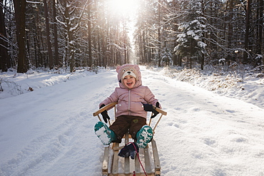 Poland, Subcarpathia, Girl having fun in winter