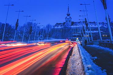 Poland, Subcarpathia, Rzeszow, Evening traffic near castle in winter