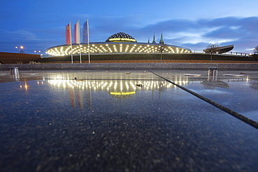 Poland, Holy Cross, Kielce, Bus station reflecting in puddle