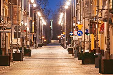 Poland, Holy Cross, Kielce, City street illuminated at night