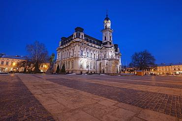 Poland, Lesser Poland, Nowy Sacz, Town hall at town square illuminated at dusk