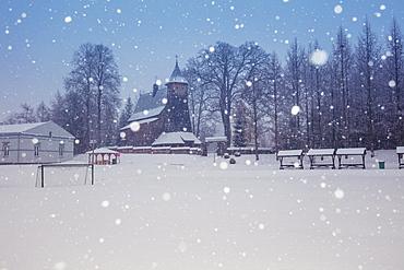 Poland, Subcarpathia, Trzcinica, Church at town square during winter snowfall