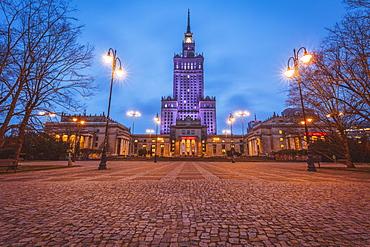Poland, Masovia, Warsaw, Illuminated high rise building at town square