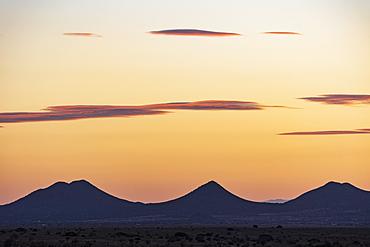 Usa, New Mexico, Santa Fe, El Dorado, Sunset sky over landscape with hills