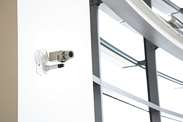 Security camera on wall of office building