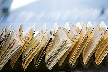 Close-up of files stacked on desk in office