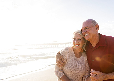 Senior couple embracing on beach, Jupiter, Florida