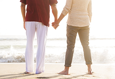 Rear view of senior couple holding hands, Jupiter, Florida