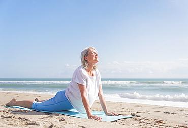 Senior woman exercising on beach, Jupiter, Florida