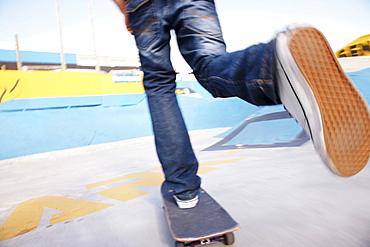 Legs on moving skateboard