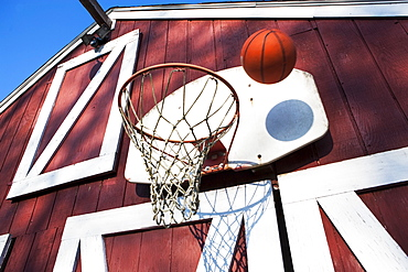 Basketball outside barn, Pennsylvania