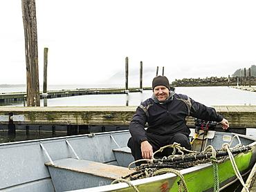Portrait of man in boat, Rockaway Beach, Oregon
