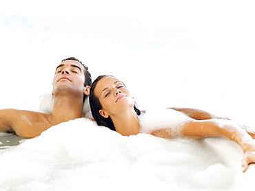 Couple relaxing in bathtub