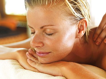 Woman relaxing in spa