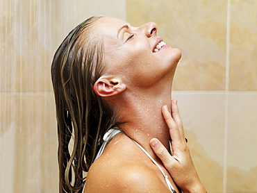Mid adult woman in spa shower