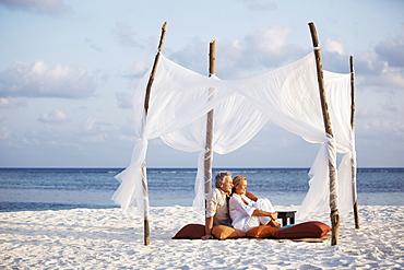 Portrait of couple on beach, Thailand