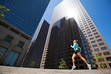USA, California, Los Angeles, Young woman running in city, USA, California, Los Angeles