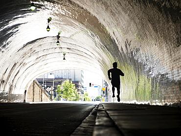 USA, California, Los Angeles, Man running in tunnel, USA, California, Los Angeles
