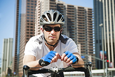 USA, California, Los Angeles, Portrait of young man road cycling on city street, USA, California, Los Angeles