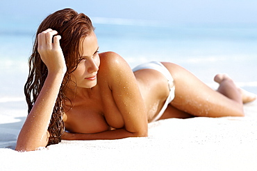 Attractive young woman relaxing on beach