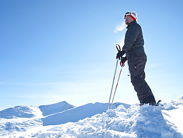 Male skier standing on mountain