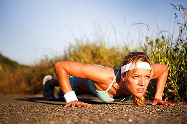 Runner doing push ups