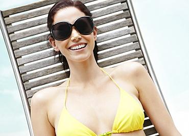 Brunette woman sunbathing